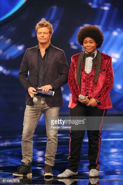Noah Schaerers and Oliver Geissen during the fourth event show and semi finals of the tv competition 'Deutschland sucht den Superstar' at Coloneum on...