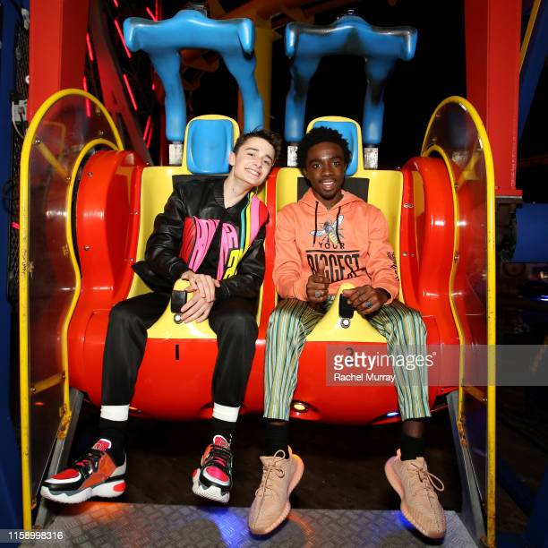 Noah Schnapp and Caleb McLaughlin attend the Stranger Things Season 3 World Premiere on June 28 2019 in Santa Monica California