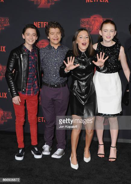 Noah Schnapp Gaten Matarazzo Millie Bobby Brown and Sadie Sink arrive at the premiere of Netflix's 'Stranger Things' Season 2 at Regency Bruin...