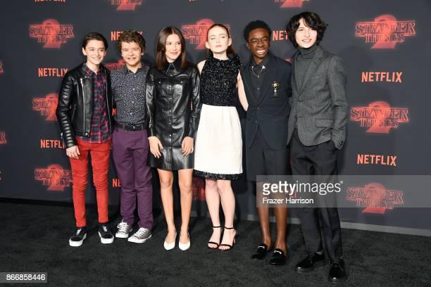 Noah Schnapp Gaten Matarazzo Millie Bobby Brown Sadie Sink Caleb McLaughlin and Finn Wolfhard attend the premiere of Netflix's 'Stranger Things'...