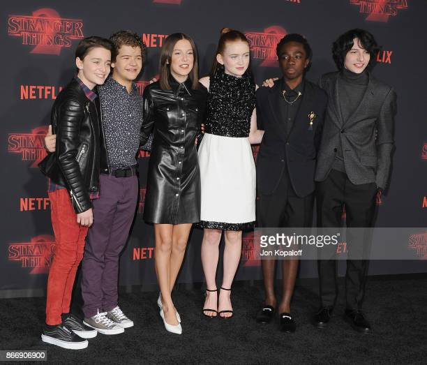 Noah Schnapp Gaten Matarazzo Millie Bobby Brown Sadie Sink Caleb McLaughlin and Finn Wolfhard arrive at the premiere of Netflix's 'Stranger Things'...