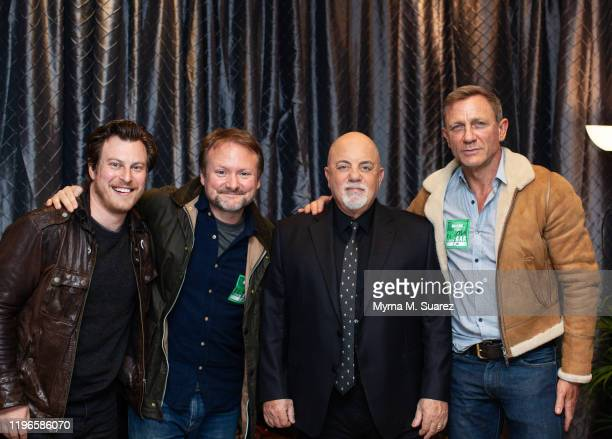 Noah Segan Rian Johnson Billy Joel and Daniel Craig backstage at Joel's 68th Sold Out Show at Madison Square Garden on January 25 2020 in New York...