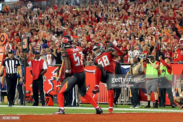 Noah Spence and Kwon Alexander of the Buccaneers celebrates a Buccaneers play during the NFL Game between the New Orleans Saints and Tampa Bay...