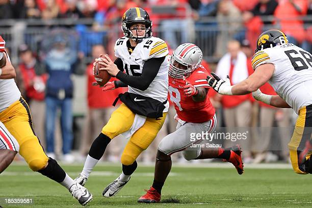 Noah Spence of the Ohio State Buckeyes forces quarterback Jake Rudock of the Iowa Hawkeyes out of the pocket in the second quarter at Ohio Stadium on...