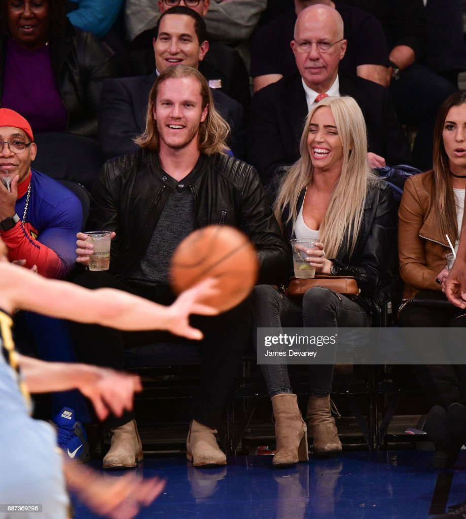 Noah Syndergaard and Alexandra Cooper attend the Memphis Grizzlies Vs New York Knicks game at Madison Square Garden on December 6, 2017 in New York City.