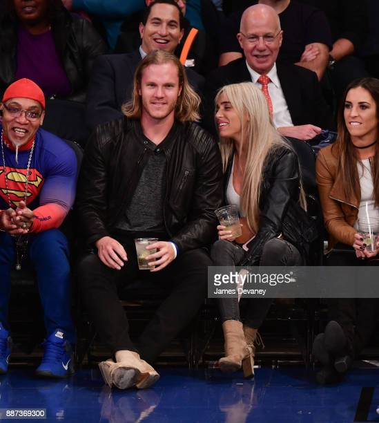 Noah Syndergaard and Alexandra Cooper attend the Memphis Grizzlies Vs New York Knicks game at Madison Square Garden on December 6 2017 in New York...