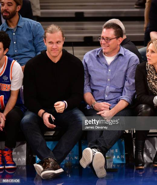 Noah Syndergaard and guest attend the Denver Nuggets Vs New York Knicks game at Madison Square Garden on October 30 2017 in New York City