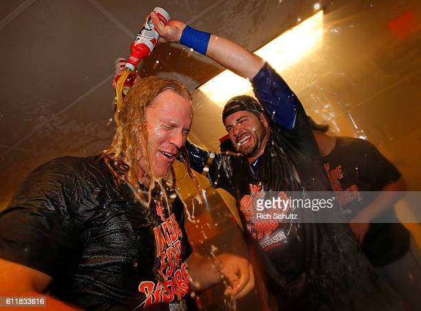 Noah Syndergaard left of the New York Mets is drenched with beer by Kevin Plawecki after the Mets defeated the Philadelphia Phillies 53 during a game...