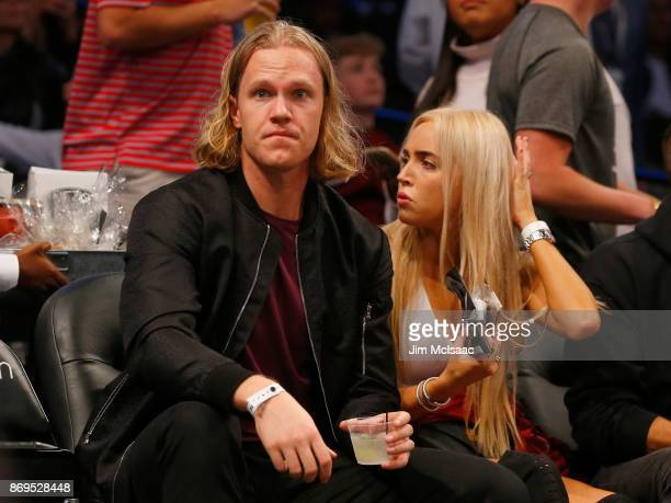 Noah Syndergaard of the New York Mets and friend Alexandra Cooper attend a game between the Brooklyn Nets and the Cleveland Cavaliers at Barclays...