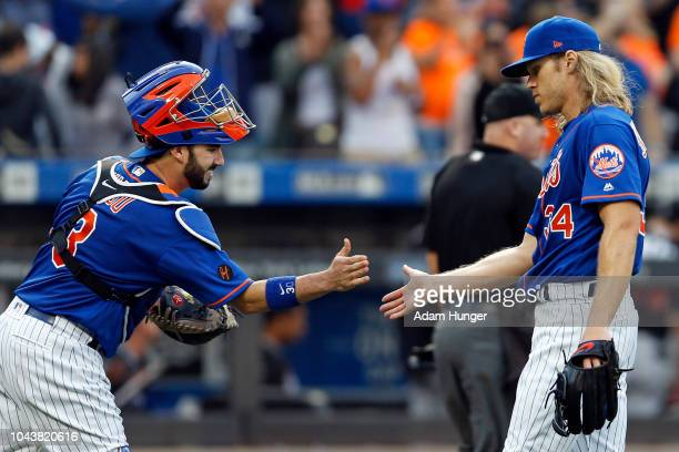 Noah Syndergaard of the New York Mets and Tomas Nido of the New York Mets celebrate after defeating the Miami Marlins at Citi Field on September 30...