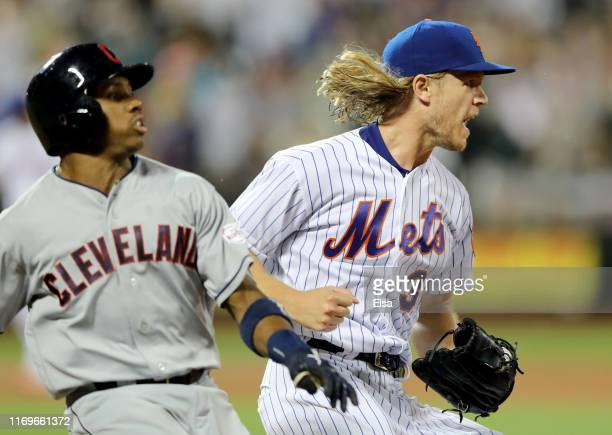 Noah Syndergaard of the New York Mets celebrates after beating Greg Allen of the Cleveland Indians to first base for the final out of the sixth...