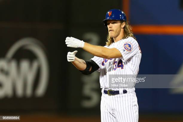 Noah Syndergaard of the New York Mets celebrates after hitting a RBI double in the second inning against the Toronto Blue Jays at Citi Field on May...