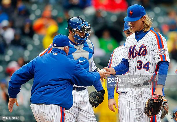 Noah Syndergaard of the New York Mets hands the ball to manager Terry Collins as he leaves a game against the San Francisco Giants in the sixth...