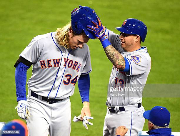 Noah Syndergaard of the New York Mets has his batting helmet removed by Asdrubal Cabrera in celebration of his solo homerun to take a 10 lead over...