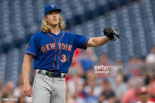 Noah Syndergaard of the New York Mets looks on after allowing a solo home run to Rhys Hoskins of the Philadelphia Phillies in the bottom of the first...