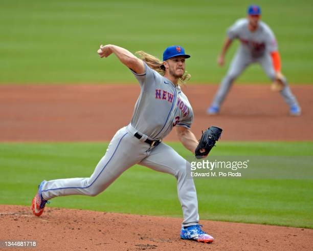 Noah Syndergaard of the New York Mets pitches against the Atlanta Braves at Truist Park on October 3, 2021 in Atlanta, Georgia.