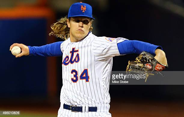 Noah Syndergaard of the New York Mets pitches in the first inning against the Kansas City Royals during Game Three of the 2015 World Series at Citi...