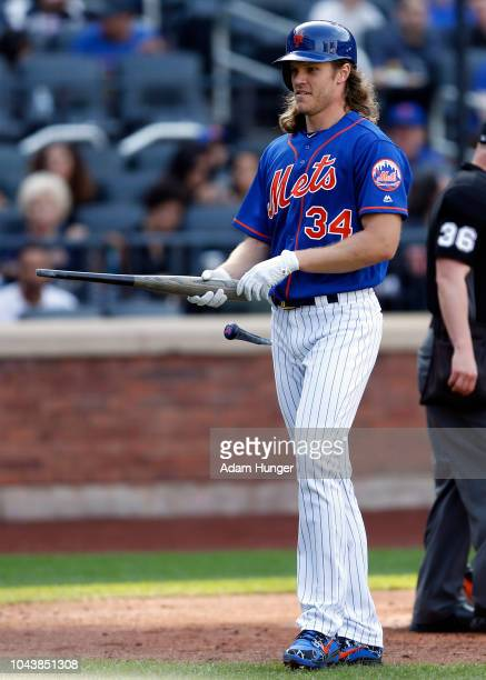 Noah Syndergaard of the New York Mets reacts to a broken bat during the fourth inning against the Miami Marlins at Citi Field on September 30 2018 in...