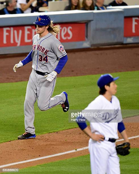 Noah Syndergaard of the New York Mets runs home after his three run homerun and second homerun of the game to take a 42 lead as Kenta Maeda of the...