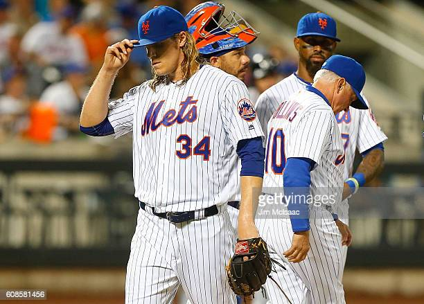 Noah Syndergaard of the New York Mets walks to the dugout in the fourth inning after being removed from a game against the Atlanta Braves by manager...