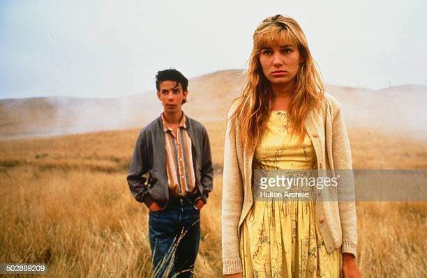 Noah Taylor and Loene Carmen walk in a wheat field in a scene from the movieThe Year My Voice Broke circa 1987