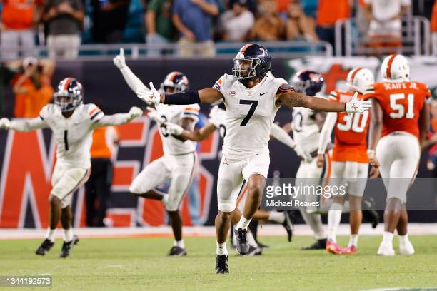 Noah Taylor of the Virginia Cavaliers celebrates after Andres Borregales of the Miami Hurricanes missed a game-winning field goal as time expired...