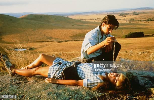 Noah Taylor tries to hypnotize Loene Carmen in a wheat field in a scene from the movieThe Year My Voice Broke circa 1987