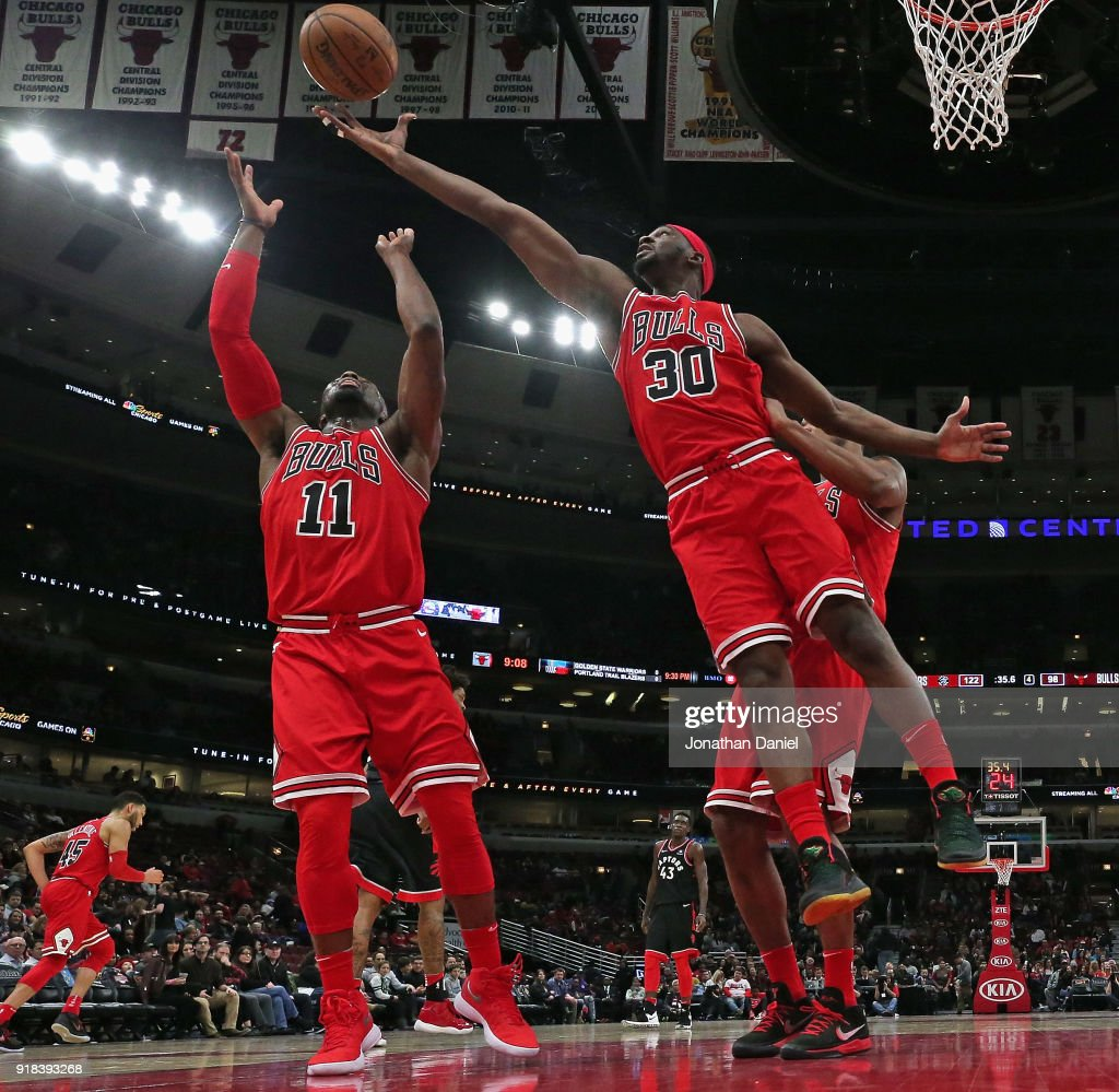 Noah Vonleh #30 and David Nwaba #11 of the Chicago Bulls battle for a rebound against the Toronto Raptors at the United Center on February 14, 2018 in Chicago, Illinois. The Raptors defeated the Bulls 122-98.