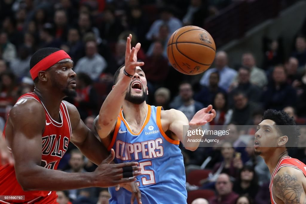 Noah Vonleh (30) of Chicago Bulls in action against Austin Rivers (C) of Los Angeles Clippers during the NBA basketball match between Chicago Bulls and Los Angeles Clippers at the United Center in Chicago, Illinois, United States on March 13, 2018.