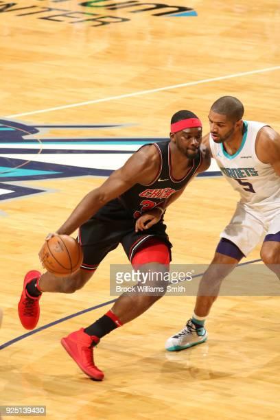 Noah Vonleh of the Chicago Bulls handles the ball against the Charlotte Hornets on February 27 2018 at Spectrum Center in Charlotte North Carolina...