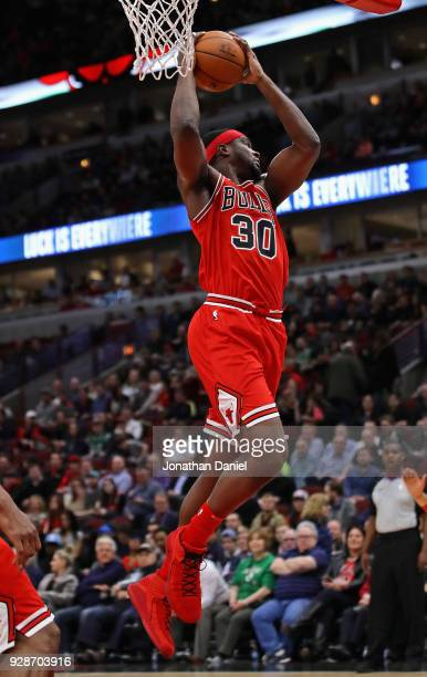 Noah Vonleh of the Chicago Bulls rebounds against the Boston Celtics at the United Center on March 5 2018 in Chicago Illinois The Celtics defeated...