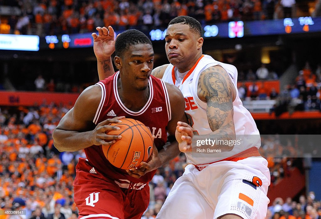 Noah Vonleh #1 of the Indiana Hoosiers drives to the basket around the defense of DaJuan Coleman #32 of the Syracuse Orange during the second half at the Carrier Dome on December 3, 2013 in Syracuse, New York. Syracuse defeated Indiana 69-52.