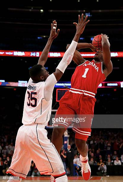 Noah Vonleh of the Indiana Hoosiers tries to make a last second shot as Amida Brimah of the Connecticut Huskies defends during the 2K Sports Classic...