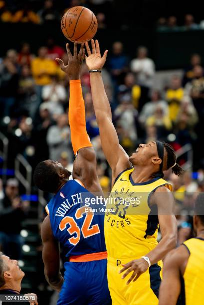Noah Vonleh of the New York Knicks and Myles Turner of the Indiana Pacers fight for the ball during tipoff during a game at Bankers Life Fieldhouse...