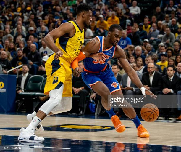 Noah Vonleh of the New York Knicks attempts to push past Thaddeus Young of the Indiana Pacers during the first period of the game at Bankers Life...
