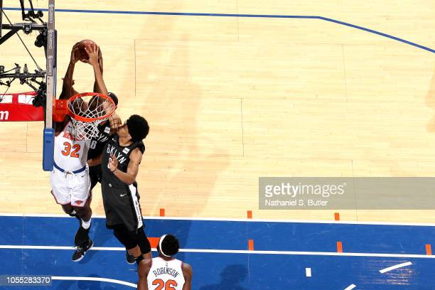 Noah Vonleh of the New York Knicks shoots the ball and gets blocked by Jarrett Allen of the Brooklyn Nets on October 29 2018 at Madison Square Garden...