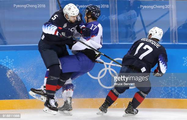 Noah Welch of the United States and Milos Bubela of Slovakia collide during the Men's Ice Hockey Preliminary Round Group B game at Gangneung Hockey...