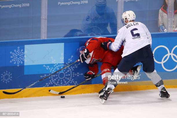 Noah Welch of the United States collides with Michal Repik of the Czech Republic during the Men's Playoffs Quarterfinals on day twelve of the...
