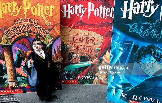 Noah Wohlson age 4 poses in front of huge displays of other books in the Harry Potter series during a Harry Potter block party July 15 2005 in New...