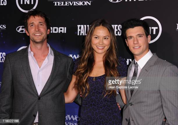 Noah Wyle Moon Bloodgood and Drew Roy arrive at the premiere of TNT's Falling Skies held at Pacific Design Center on June 13 2011 in West Hollywood...