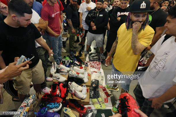 Noam Attias calculates a sale price for a sneaker collection for Jaysse Lopez owner of Urban Necessities during SneakerCon 2019 at Fort Lauderdale...