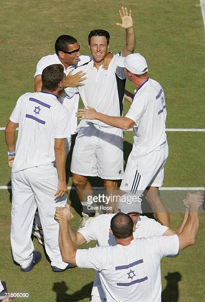 Noam Okun of Israel celebrates with his team after winning the fourth rubber singles match against Jamie Delgado of Great Britain in the Euro/Africa...