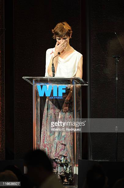 Noami Wilding accepts The Norma Zarky Humanitarian Award presented by PANDORA on behalf of her grandmother Dame Elizabeth Taylor during the 2011...