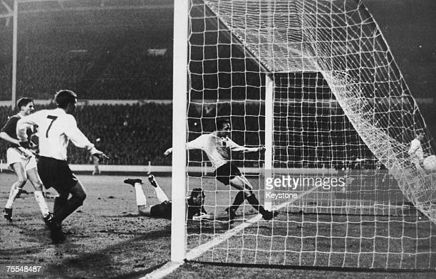 Nobby Stiles, centre, scoring during an international friendly against West Germany at Wembley Stadium, 23rd February 1966. It was the only goal of...