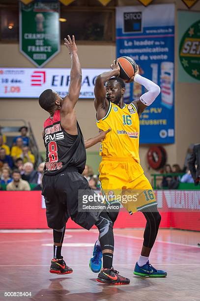 Nobel BoungouColo #16 of Limoges CSP competes with DJ Strawberry #8 of Olympiacos Piraeus during the Turkish Airlines Euroleague Basketball Regular...