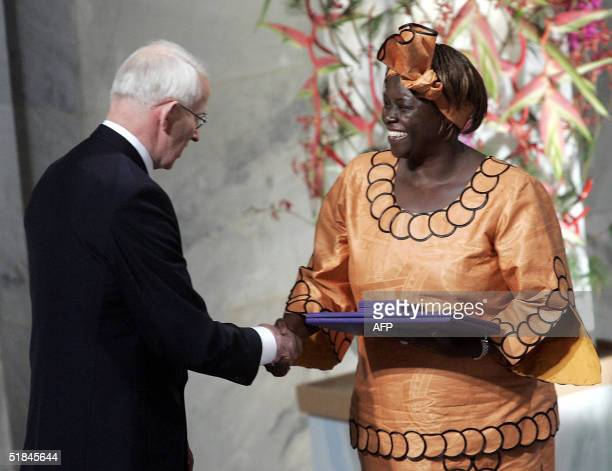 Nobel Committee President Ole Mjoes congratulates Kenyan 2004 Nobel peace prize laureate Wangari Maathai 10 December 2004 in Oslo after awarding her...