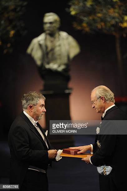 Nobel economy prize laureate Paul Krugman of the United States receives his award from Swedish King Carl XVI Gustaf in Stockholm on December 10 2008...