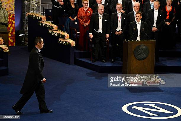 Nobel Laureate Professor Shinya Yamanaka of Japan walks to the center of the stage to receive his Nobel Prize for Medicine from King Carl XVI Gustaf...