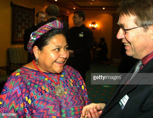 Nobel laureate Rigoberta Menchu with Oslo Bishop Gunnar Staalsett during a break in Friday's session of the Nobel Peace Prize Centennial Symposium...