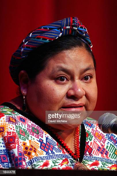 Nobel Laureate Rigoberta Menchu's eyes fill with tears as she explains that many of her family members and relatives were murdered by the military in...